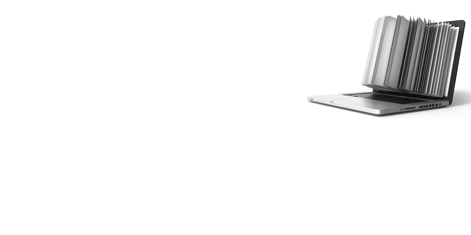 Ein Buch ragt aus dem Bildschirm eines Laptops.